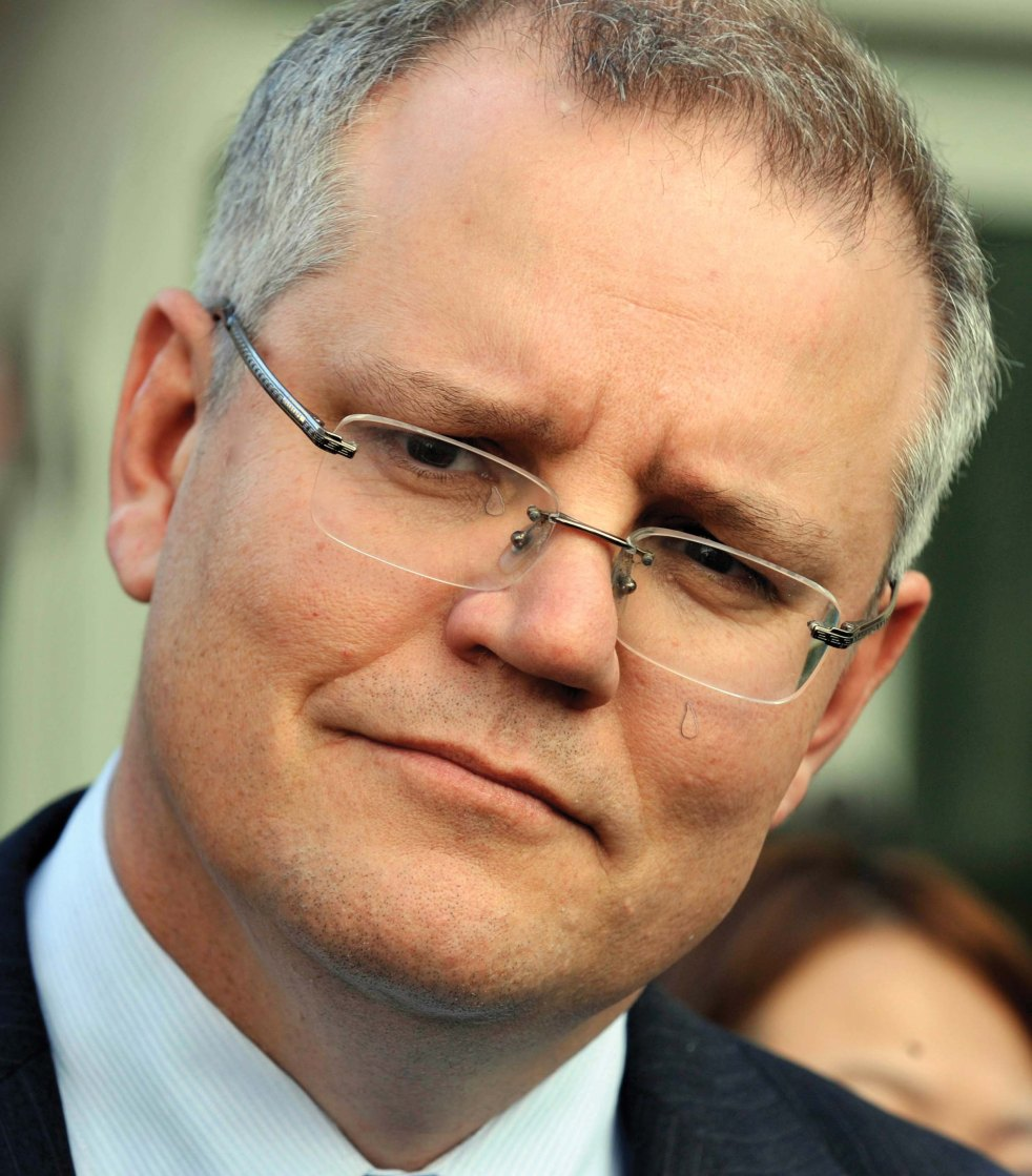 Shadow immigration minister Scott Morrison speaking during a press conference in Canberra, Monday, Aug. 13, 2012. Mr Morrison was responding to the release of the expert advisory group asylum seeker report. (AAP Image/Alan Porritt) NO ARCHIVING