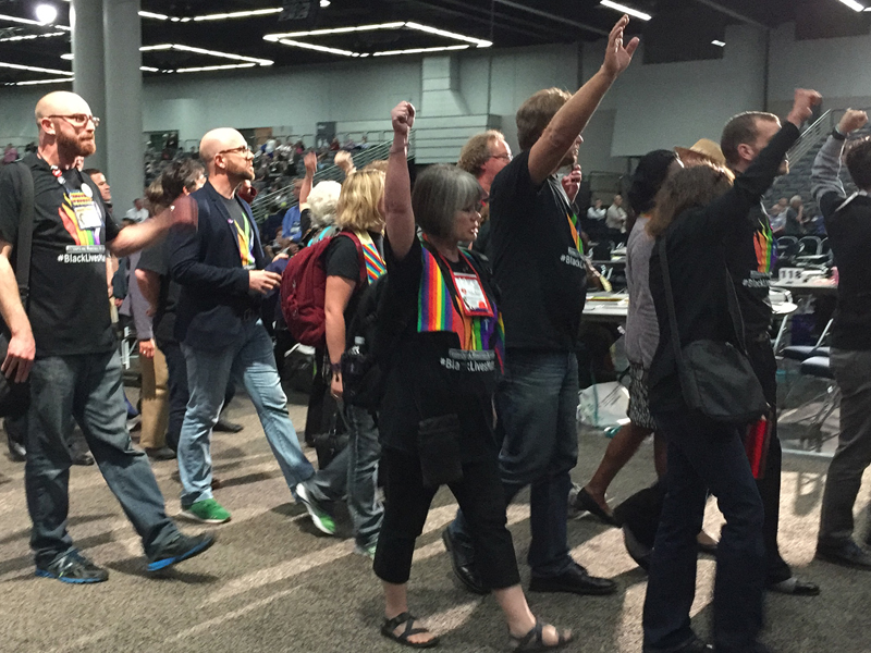 About 150 protestors shut down the afternoon plenary session on May 16, 2016, during the United Methodist General Conference for about 20 minutes as the quadrennial conference started its second week. Religion News Service photo by Emily Miller